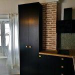 Reforma de apartamento con recuperación de techos de madera